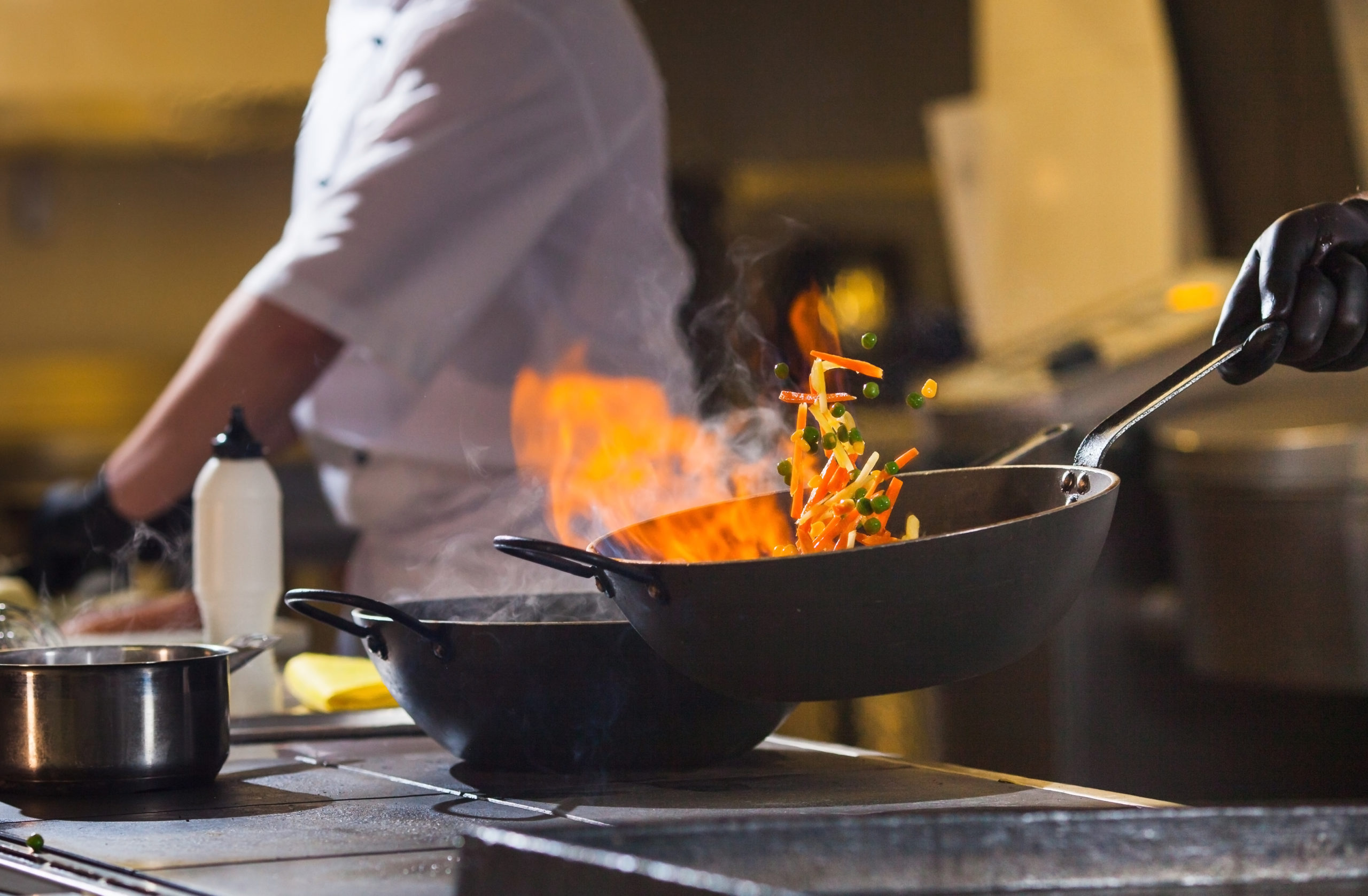 cook making dinner in the kitchen of high-end restaurant